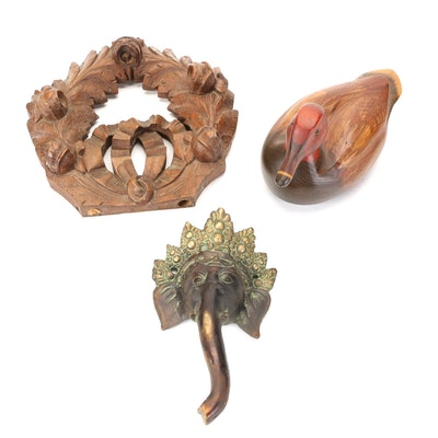 Carved Wood Duck Decoy, Floral Motif Wall Décor, and Cast Metal Elephant Head