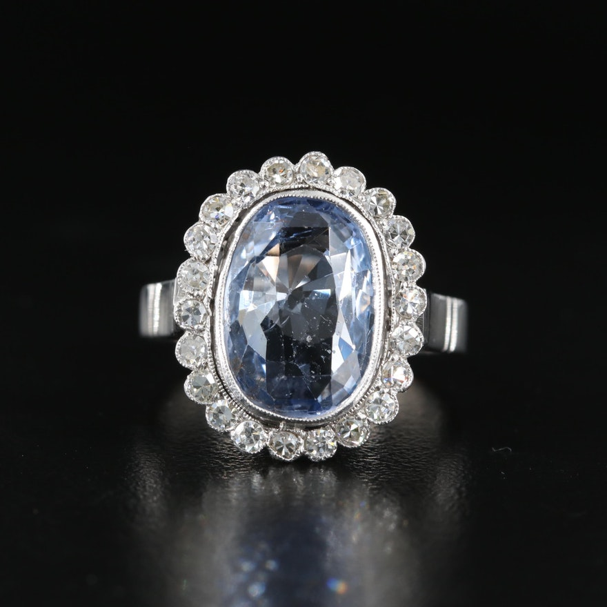 Platinum and 10K 6.29 CT Unheated Sapphire and Diamond Halo Ring with GIA Report