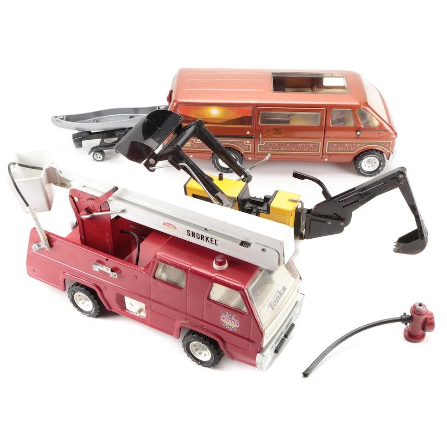 Tonka Pressed Steel Snorkel Fire Truck, Van with Trailer, and Bulldozer, 1970s