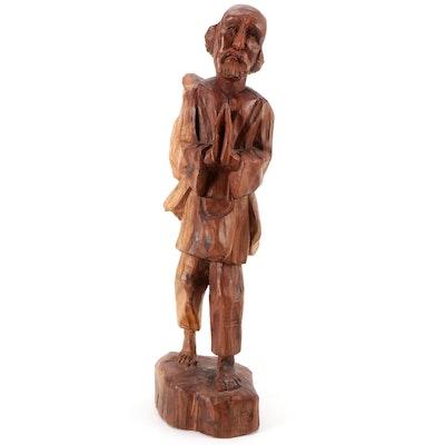 Hand-Carved Religious Pilgrim Wood Figurine