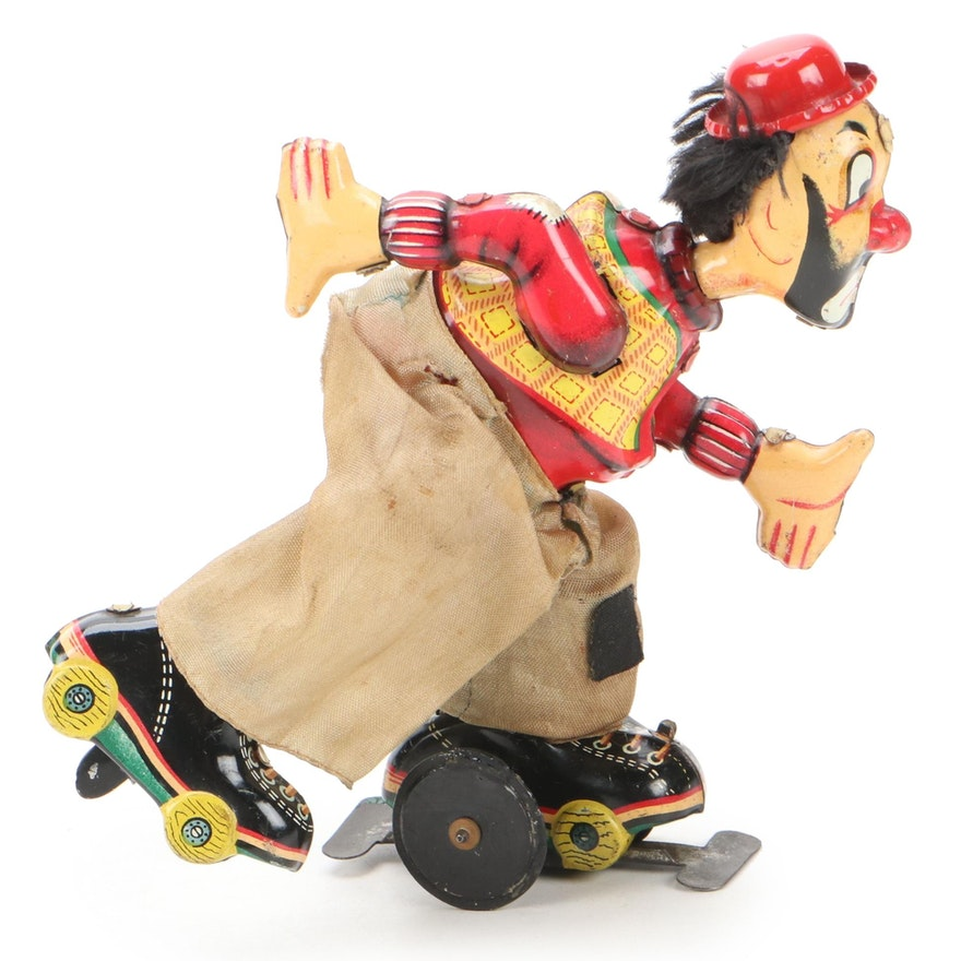 TPS Japan Wind-Up Tin Litho Roller Skating Clown