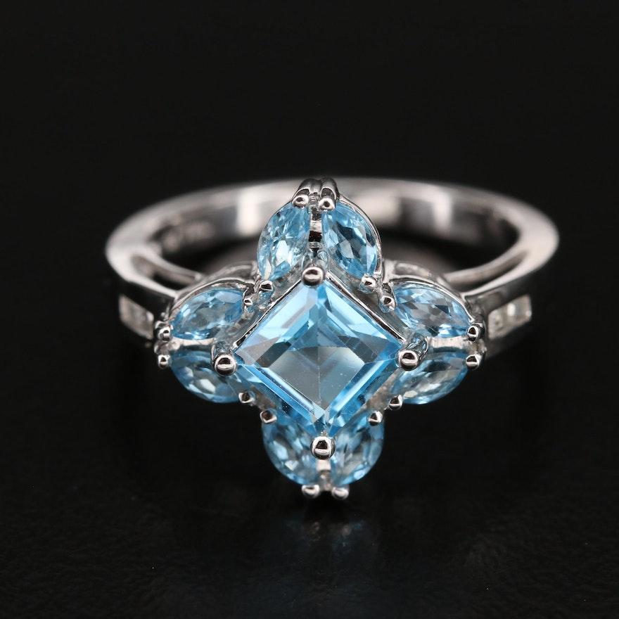 10K Swiss Blue Topaz and 0.05 CTW Diamond Quatrefoil Ring
