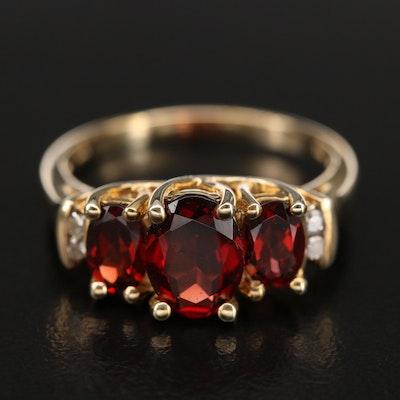 10K Garnet and 0.06 CTW Diamond Trellis Ring