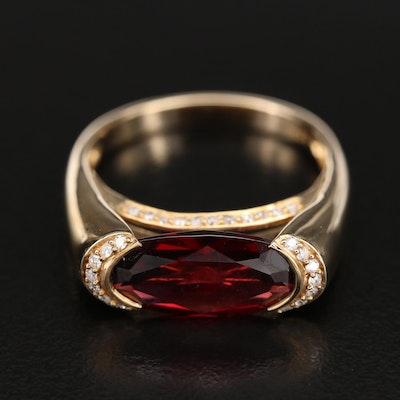14K Garnet and 0.25 CTW Diamond East-West Ring