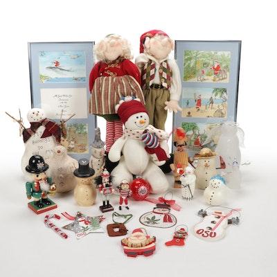 Assorted Seasonal Decor Featuring Snowmen, Wall Hangings, and O.S.U. Ornaments