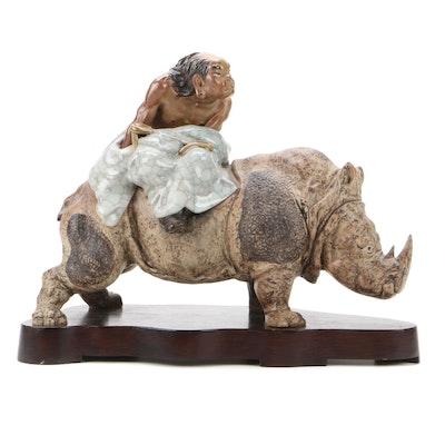 Chinese Shiwan Ware Figurine of Man Riding a Rhino
