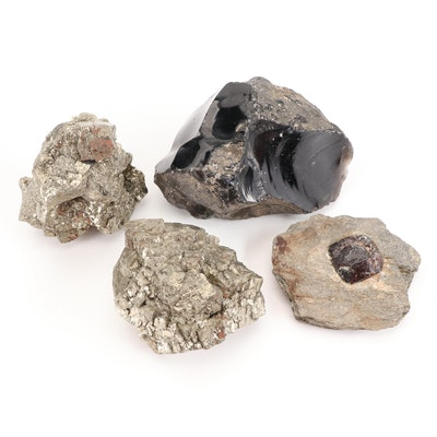 Pyrite, Obsidian, and Raw Garnet in Stone Specimens
