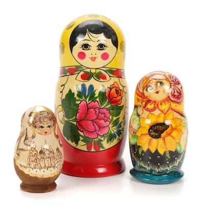 Three Sets of Hand-Painted Russian Matroshka Nesting Dolls