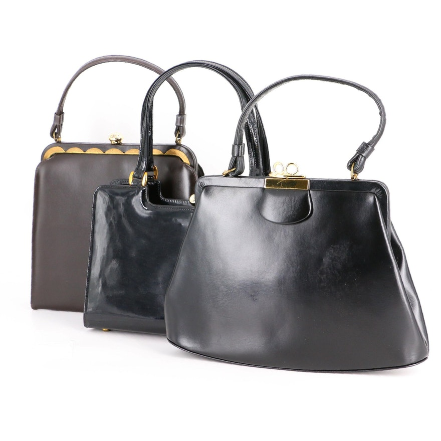 Top Handle Clasp Bags in Black Leather and Patent Leather
