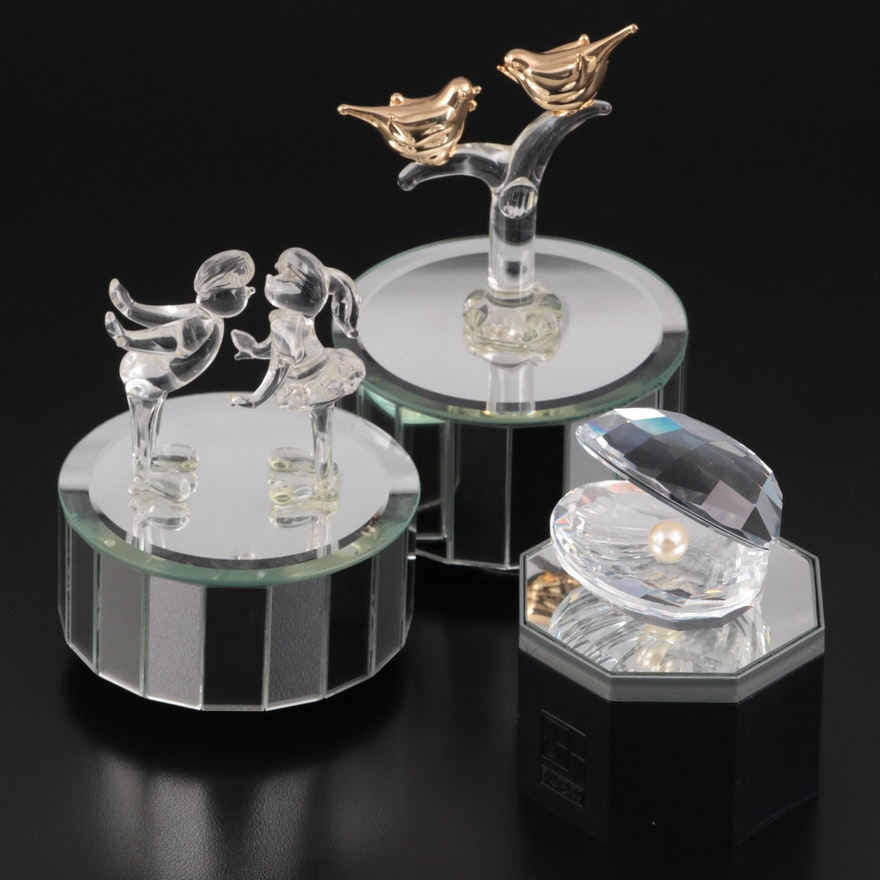 Swarovski Oyster Figurine and Mirrored Stand with Other Mirrored Music Boxes