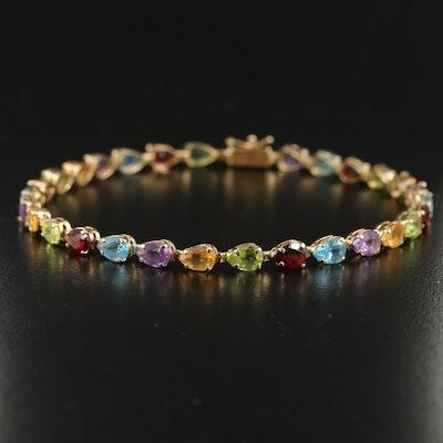 14K Mixed Gemstone Line Bracelet Including Topaz and Garnet