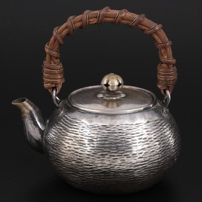 East Asian Embossed Silver Plate Teapot with Wicker Handle