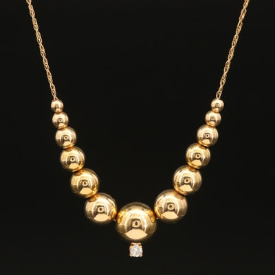 14K Graduated Bead Necklace with 0.10 CT Diamond Accent