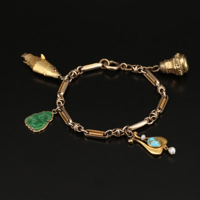 Vintage 14K Charm Bracelet with Articulated Fish, Fob and Jadeite Buddha Charms