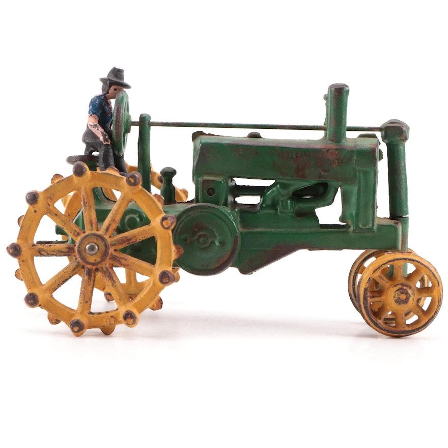 John Deere Cast Iron Tractor with Cast Iron Figurine