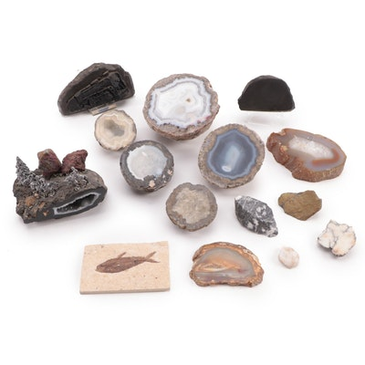 Pewter Figures on Geode, Pennsylvania Slag, Geodes, and More Mineral Specimens