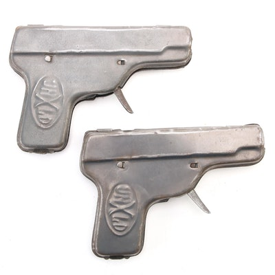 """Unexcelled Mfg. Co. """"UNXLD"""" Repeating Toy Cap Pistols, Early 20th Century"""