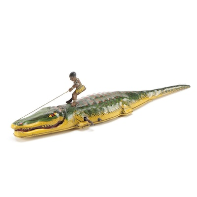 J. Chein Man Riding Alligator Wind-Up Tin Litho Toy, Early 20th Century