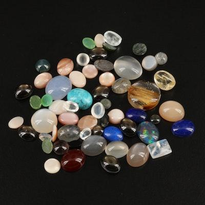 Loose Gemstones Including Rutilated Quartz, Black Star Sapphire and Labradorite