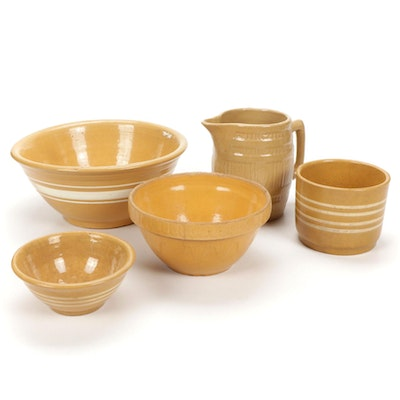 Yellow Stoneware Mixing Bowls with White Stripes and Pitcher