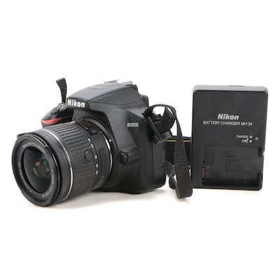 Nikon D3500 Digital SLR Camera with 18-55mm Lens and Battery Charger