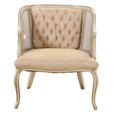 Louis XV Style Cream-Painted, Parcel-Gilt, Caned, and Buttoned-Down Bergère