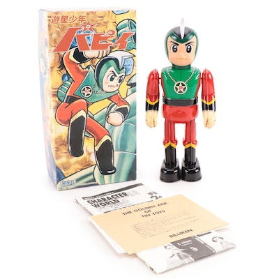 Prince Planet Wind-Up Walking Tin Toy