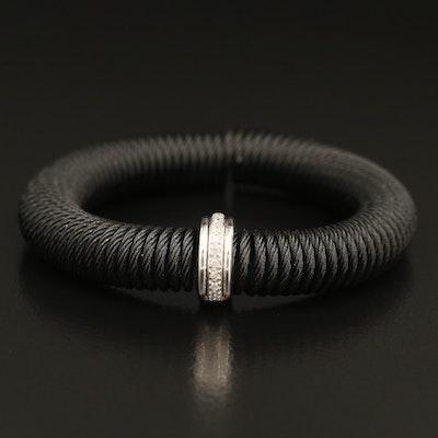18K 0.09 CTW Diamond Band on Coiled Stainless Steel Bracelet