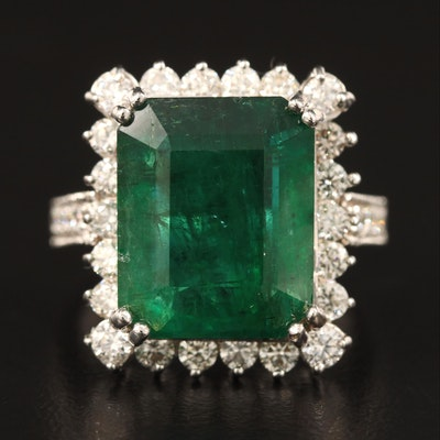 18K 7.58 CT Emerald and 1.50 CTW Diamond Halo Ring