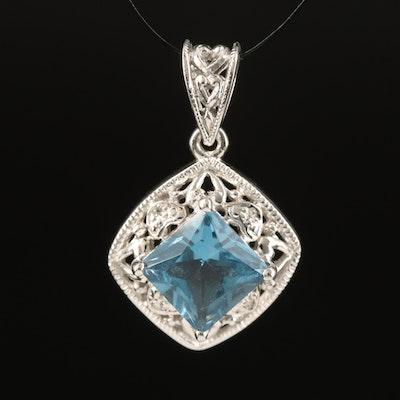 10K London Blue Topaz and Diamond Pendant