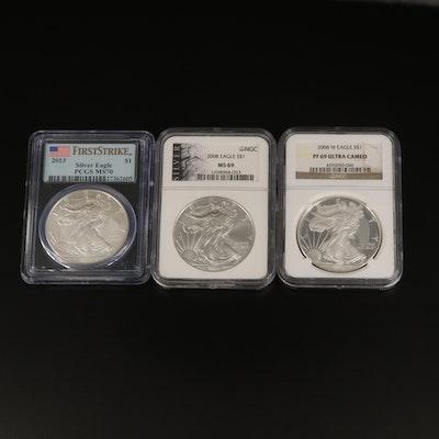 Three Graded $1 American Silver Eagle Bullion Coins