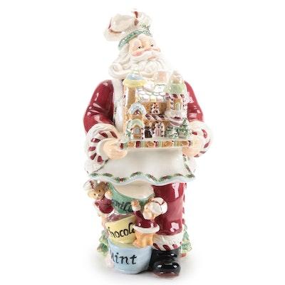 Kaldun and Bogle Ceramic Santa Holding a Gingerbread House
