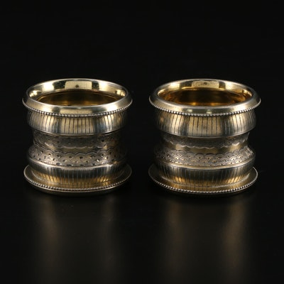Pair of Chased and Engraved Gold Washed Metal Napkin Rings