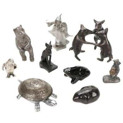 Eight Decorative Figurines Featuring a Wizerd, Penguin, Turtle, Bear, Etc