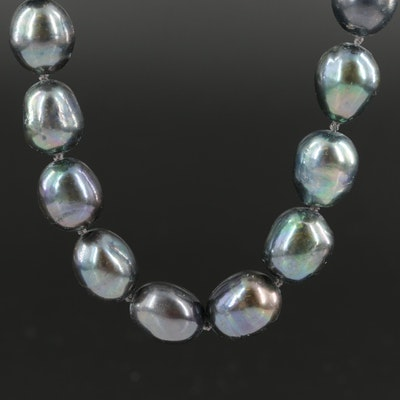 Pearl Necklace with Cubic Zirconia and Ruby Feline Door Knocker Clasp