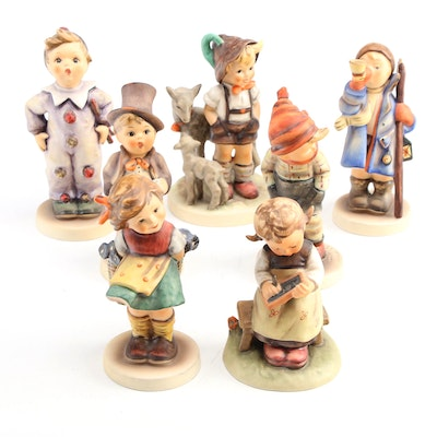 """Goebel """"March Winds"""" with Other Porcelain Hummel Figurines"""