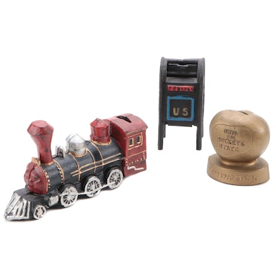Painted Cast Iron Train, Buckeye, and Air Mail Coin Banks, Mid to Late 20th C.