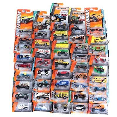"Matchbox 1:64 Scale Diecast Cars by Mattel with ""Porsche Cayenne Turbo"""