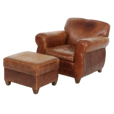Leather Upholstered Armchair and Ottoman