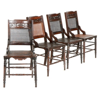 Four Victorian Carved Walnut Side Chairs with Woven Cane Seating