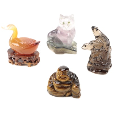 Carved Tiger's Eye Budai with Fluorite Cat and Other Carved Stone Figurines
